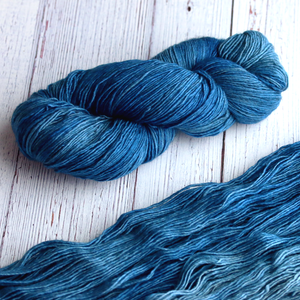 A twisted hank of Plymouth Yakima Yarn in Midnight blue