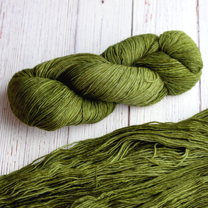 A twisted hank of Plymouth Yakima Yarn in Pine green