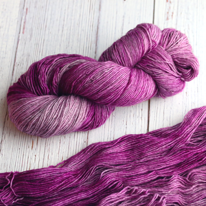 A twisted hank of Plymouth Yakima Yarn in Raspberry pink