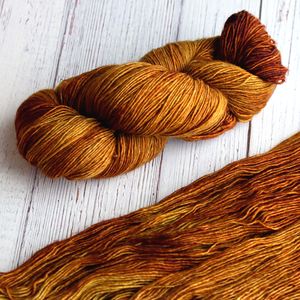 A twisted hank of Plymouth Yakima Yarn in Sienna brown