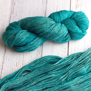 A twisted hank of Plymouth Yakima Yarn in Teal blue