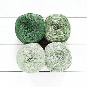 Gradient #712, 4 cakes of yarn fading from a forest green to pale green.