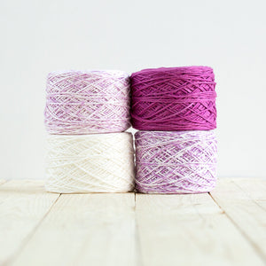 Gradient #515, 4 cakes of yarn fading from a purplish pink to white.