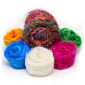 A colorful pile of Recycled Sari Silk Roving.