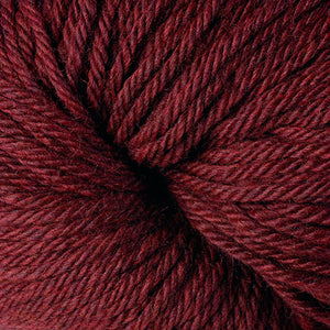 Berroco Vintage Chunky weight yarn in the color Black Cherry 6181, a dark red.
