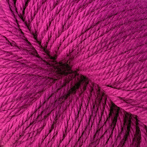 Berroco Vintage Chunky weight yarn in the color Dewberry 6167, a bright purple-pink.