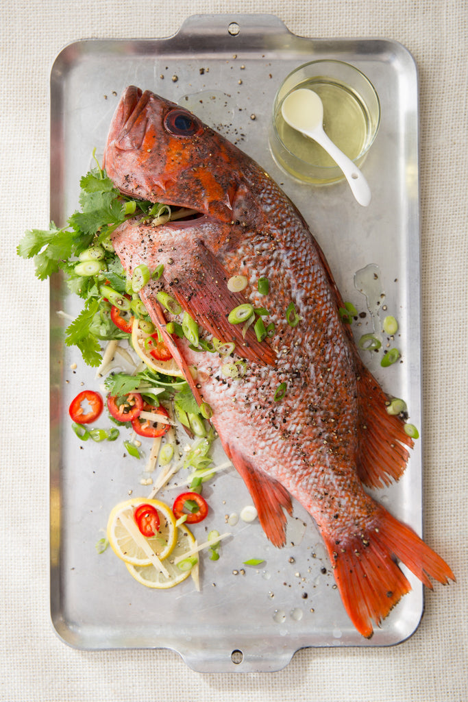 Whole fish with citrus, ginger and herbs. Fried lightly in avocado oil