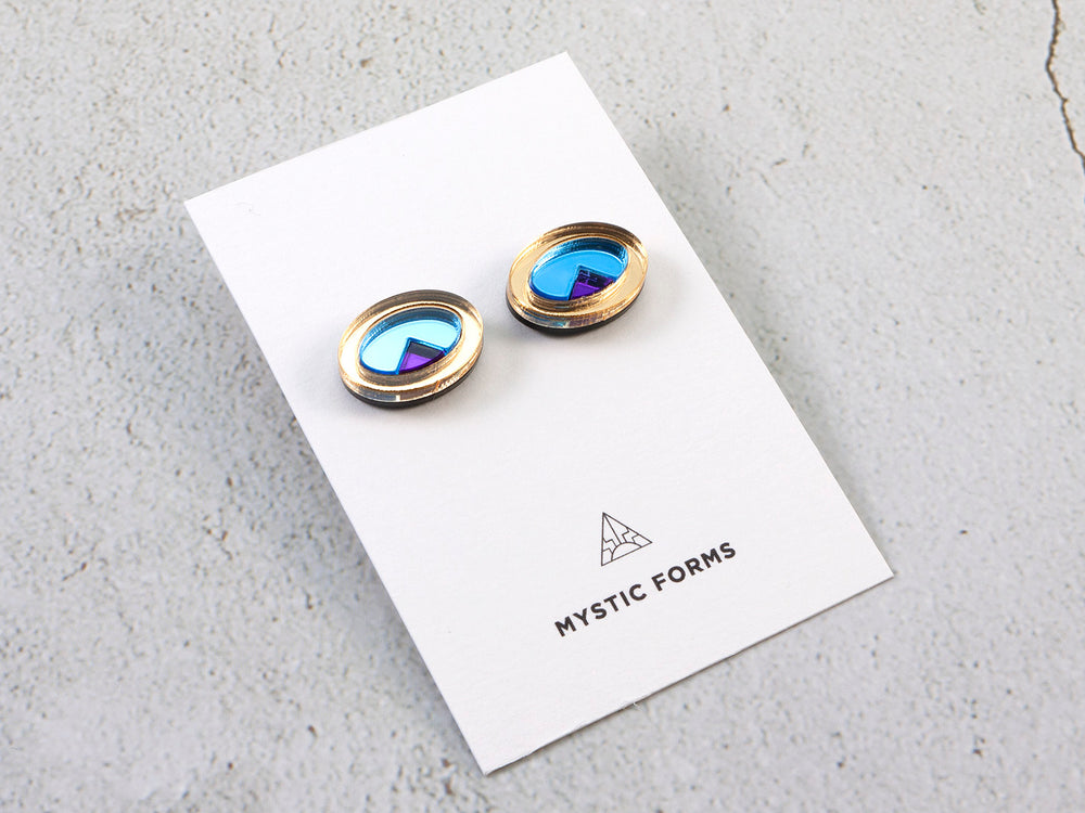 FORM053  OJO DE DIOS I Stud Earrings - Gold, Ice Blue, Purple