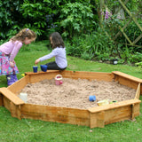Children's sandpit with integrated benches