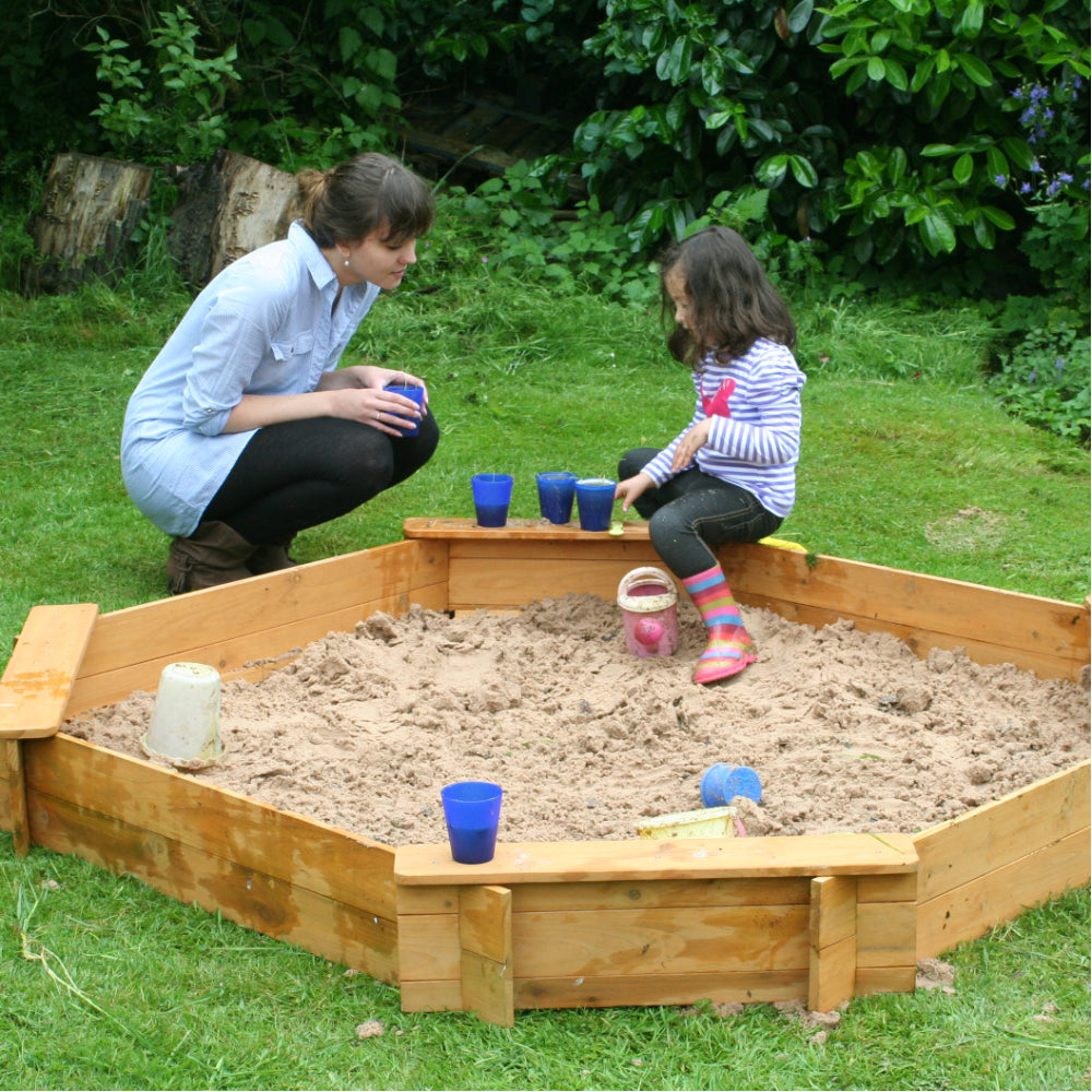 Large octagonal sandpit with seating