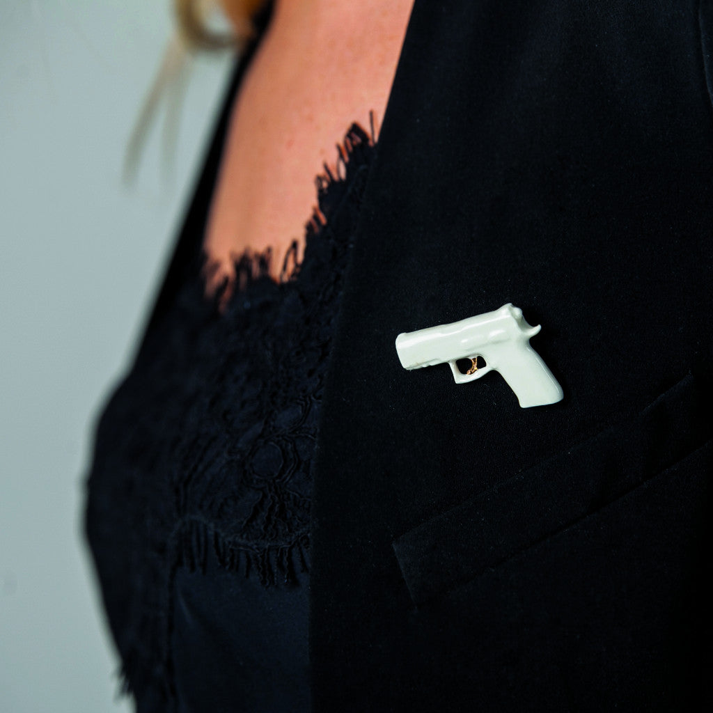 "Brooch ""Bang!"" with golden trigger"