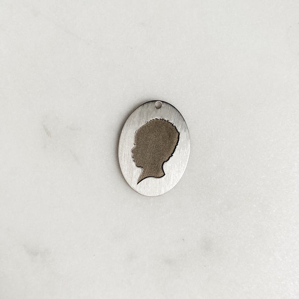 The *Statement* Silhouette Coin Charm