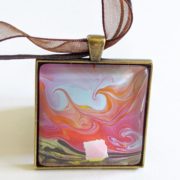 watermarbled pendant of pink house at dawn