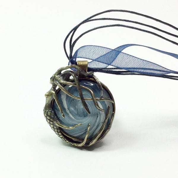 Brass mermaid pendant with blue wave