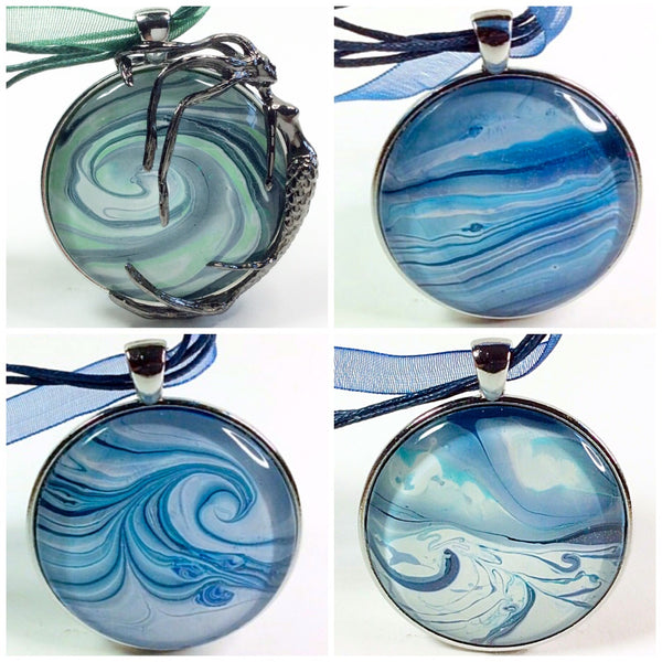 four ocean inspired painted pendant necklaces