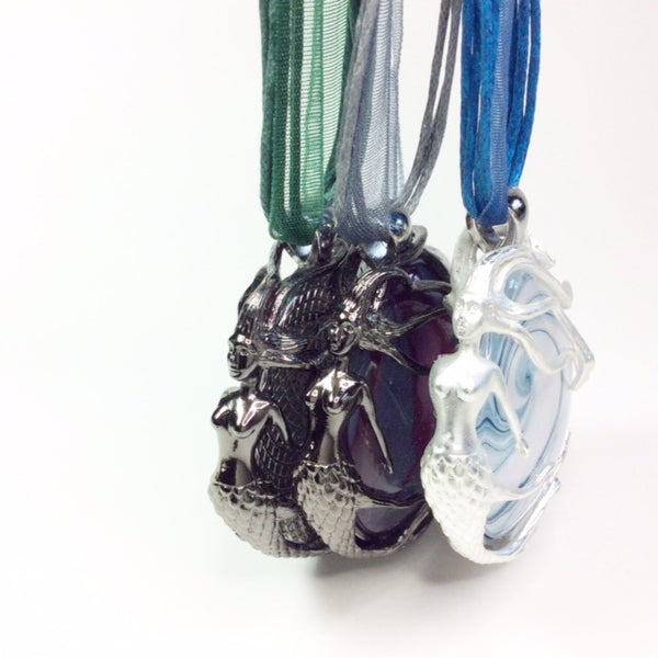 lineup of three mermaid pendant necklaces