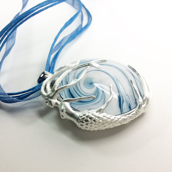 silver mermaid on wave pendant