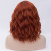 Natural red orange medium curly middle part wig by Smart Wigs Adelaide
