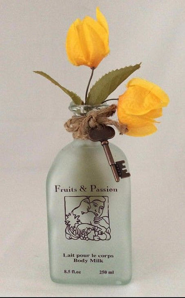 Glass Bottle Vase With Yellow Bougainvillea Flowers