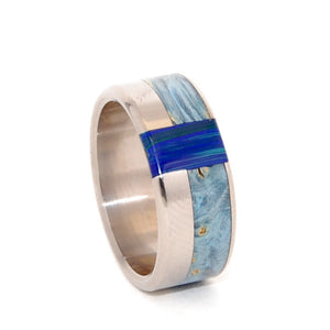 "This beautifully crafted, titanium wedding ring has a generous offset inlay of Blue Box Elder with an inset inlay of Azurite. The name ""Kuanos"" is taken from Greek, meaning 'deep blue.' The Blue Box Elder has hints of yellow burl. Nicely polished with a mirror finish and fully rounded edges. One wide edge and one thin edge. Pictured at 8mm."