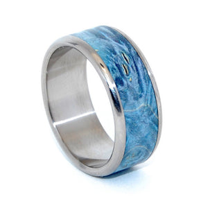 This beautifully crafted, titanium wedding ring has a center inlay of Blue Box Elder. Nicely polished with a mirror finish and fully rounded edges. Pictured at 10.5mm.