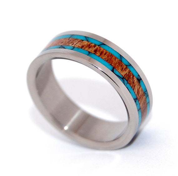 Wood over Water. This gorgeous ring is the perfect balance of Koa Wood and Turquoise. Standard width titanium edge with a mirror finish. Pictured at 6.4mm