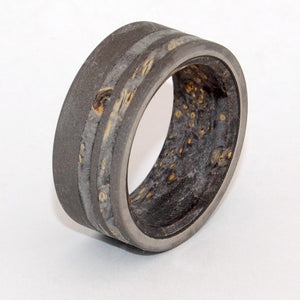 Onyx. This beautifully crafted, titanium wedding band has an offset double inlay of Black Box Elder wood, and with an interior overlay of Black Box Elder. Sandblasted finish.