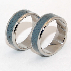 Full of surprises. Concrete is modern and timeless, with unlimited possibilities in style, texture and color. This band set is the perfect blend of smooth blue gray and sleek obsidian stone set flush in Inox, stainless steel, smooth to the touch - and is set off by a mirror finish. Fully rounded edges.