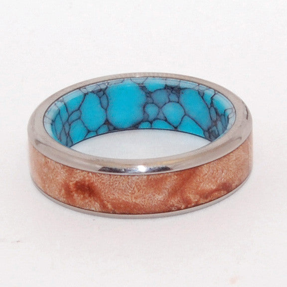Conifer. This beautifully crafted, titanium wedding band has a center inlay of rich Light Maple wood, and with an interior overlay of webbed turquoise. Mirror finish. Fully rounded edges.