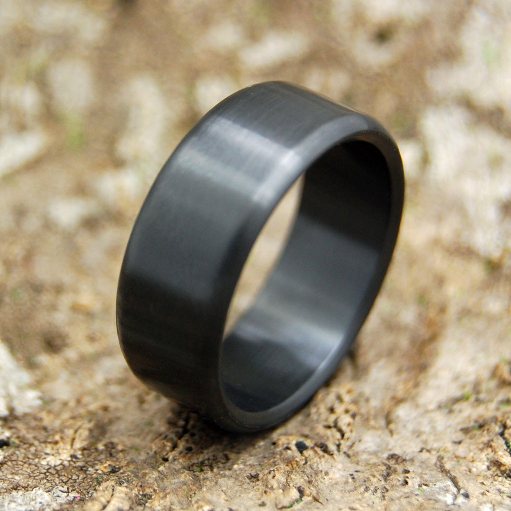 It is a photo of ATOMIC NUMBER 44 Zirconium Black Wedding Rings Minter and