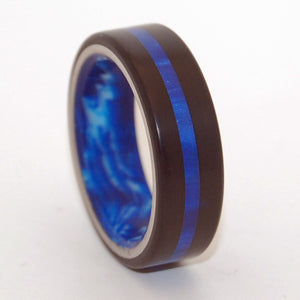 Center of My Galaxy. This beautifully crafted, titanium wedding ring has generous inlays of Black and Blue Marbled opalescent resins. Generous interior overlay of Blue Vintage opalescent resin.