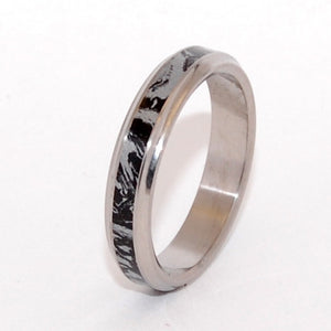 This beautifully crafted, titanium wedding ring has a center inlay of Black Silver Mokume Gane (M3) imported from Japan. Nicely polished with a mirror finish and flared edges. Pictured at 4.8mm.