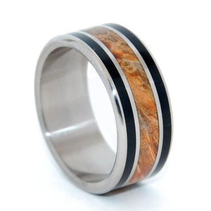 This beautifully crafted, titanium wedding ring has three inlays. A rich center inlay of Golden Box Elder bookended by 2 inlays of Water Buffalo horn. Strong enough to withstand the impact of two 1200 pound creatures headbutting each other... Water Buffalo horn is naturally tested and durable! Jet black with dark chocolate undertones, it complements titanium's shine and creates a gorgeous band. Fully rounded edges. Polished with a mirror finish. Pictured at 7.9mm.