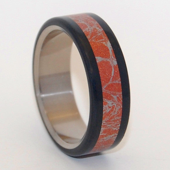 Akita features a center inlay of Red Silver M3 Mokume, bookended by Black resin. Flat edges