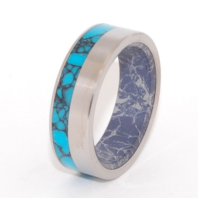 This beautifully crafted, titanium wedding ring has an exterior offset inlay of Arizona webbed Turquoise and an interior overlay of Blue Silver M3 Mokume. The aqua rich hue and contrasting graphite tone of the Blue Silver M3 Mokume gives this band a modern appeal. Nicely polished with a mirror finish and flat edges. Pictured at 8mm.