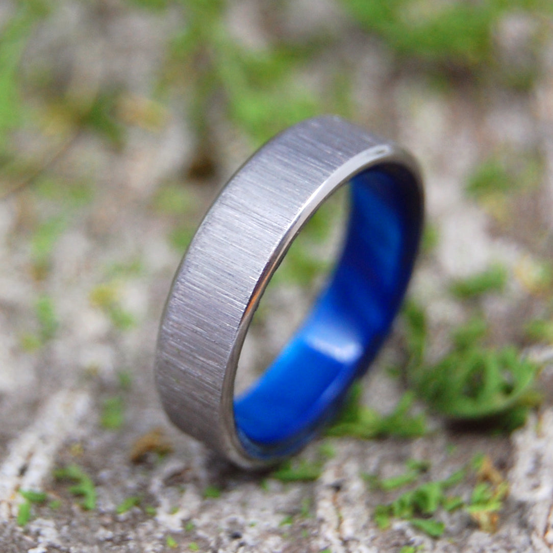 PRINCESS WITH A LEFT JAB | Handcrafted Blue Resin & Titanium Wedding Rings - Minter and Richter Designs