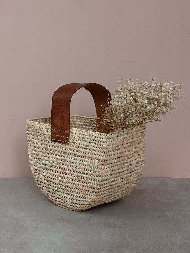 Forage basket with tan leather handle by Bohemia design filled with dried flowers