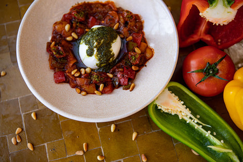 Moroccan dish with peppers and burata
