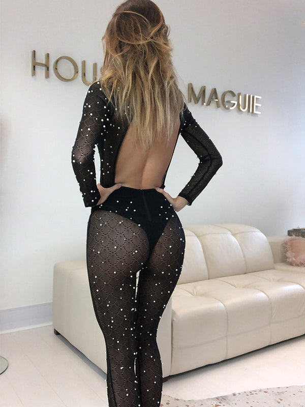 Black catsuit, celebrity clothing London, celebrity boutique, Zara jumpsuit, party catsuit