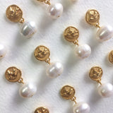 Swallow buttons and pearls