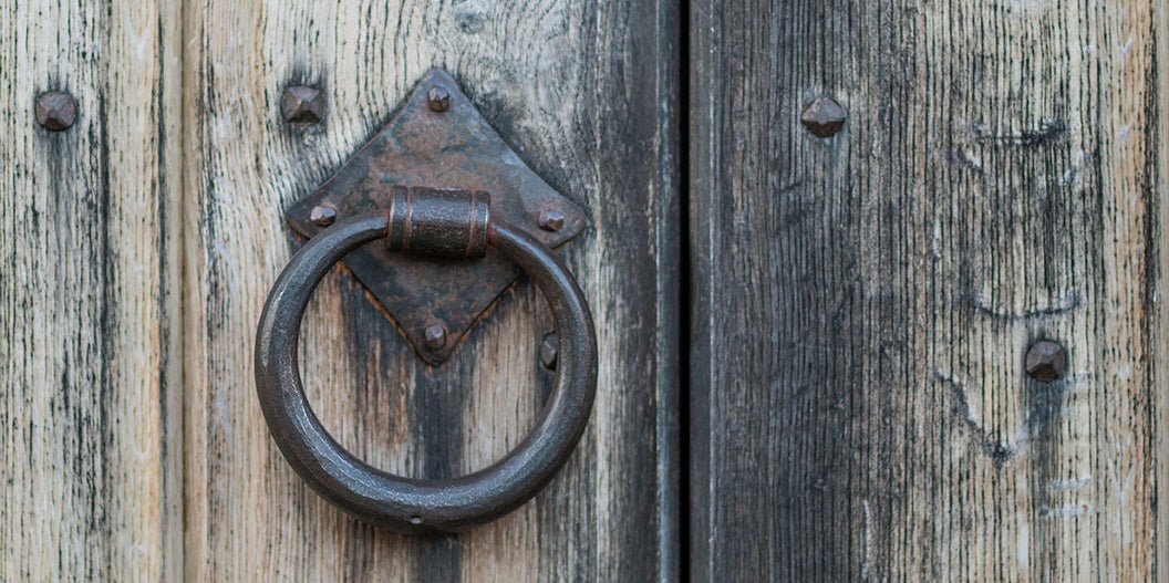 antiue door with door knocker in Clare, Suffolk