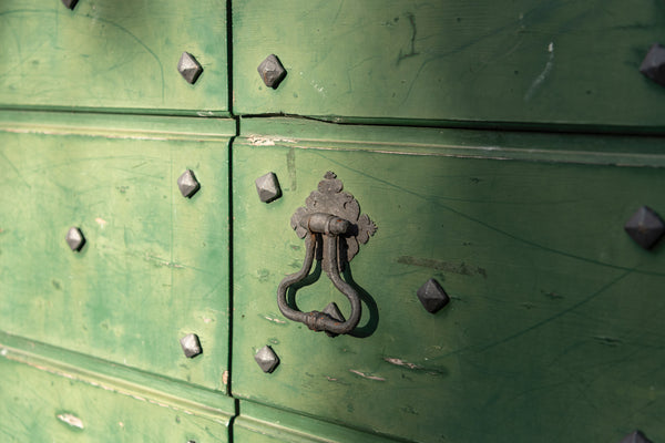 Studs on antique door Varenna lake Como