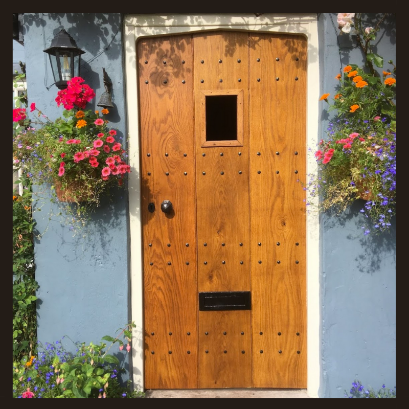 Period property front door with decorative nails