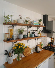 kitchen with decorative bracket shelving
