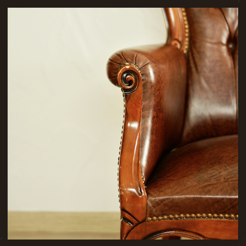 Furniture upholstery studs on a leather chair