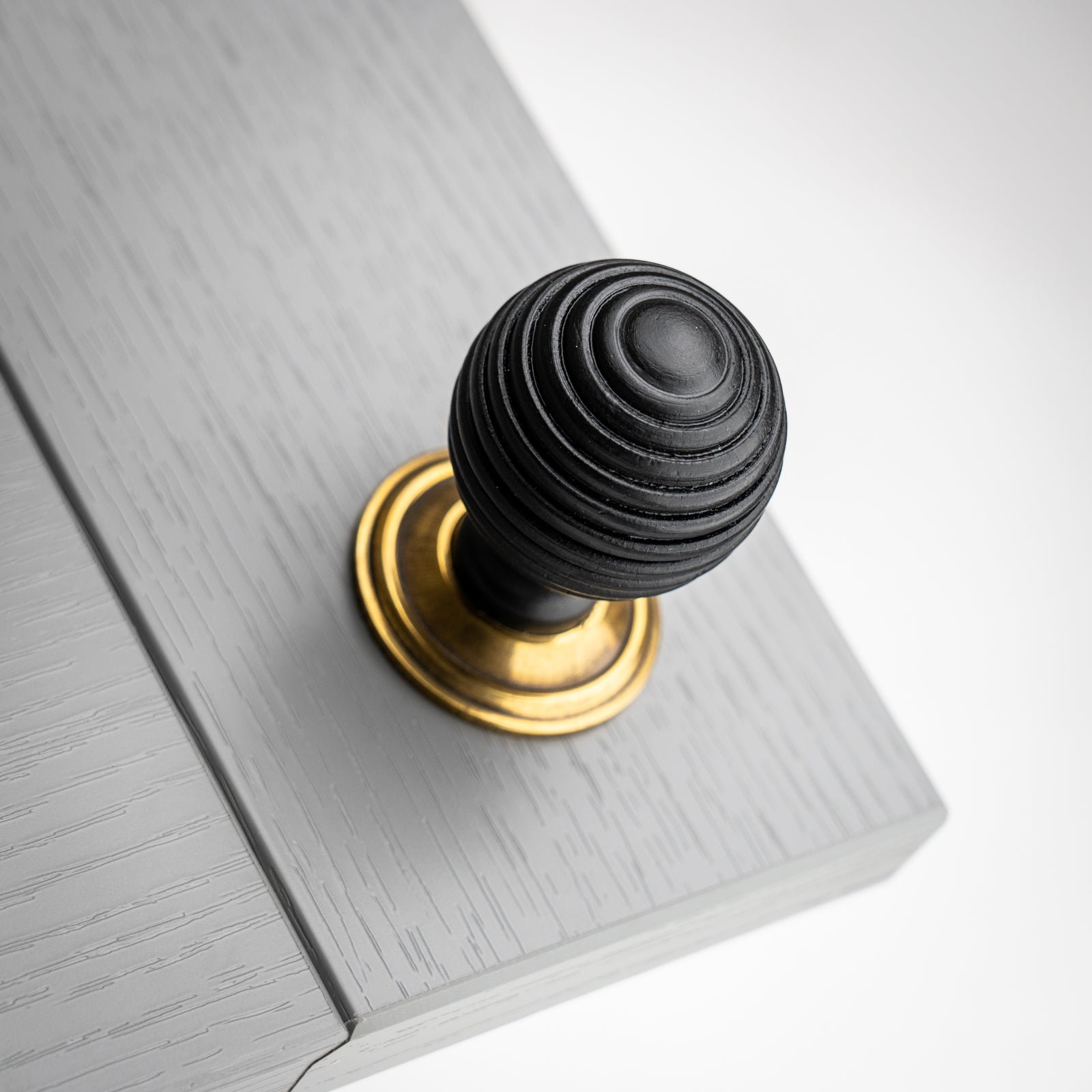 Beehive Ebonised Cabinet Knob with Antique Brass Rose Plate SHOW