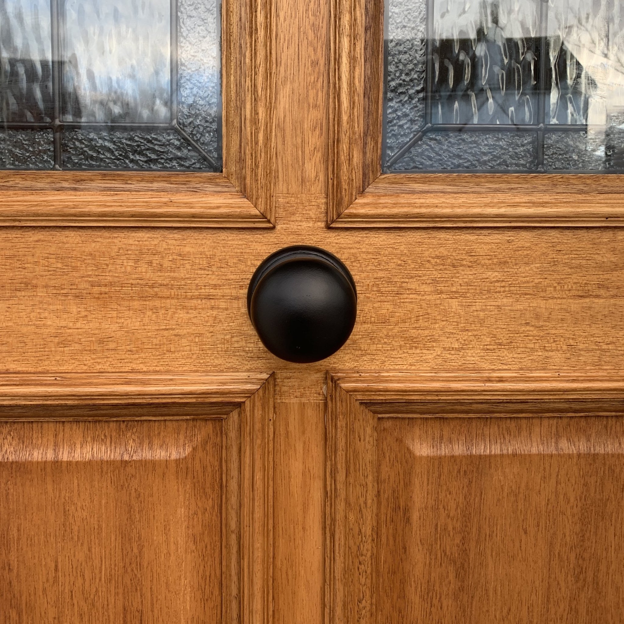 SHOW Centre Door Knob on wooden front door
