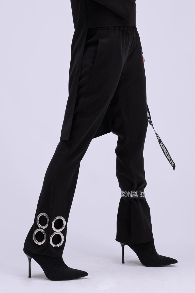 Shop Emerging Contemporary Conscious Womenswear Brand Too Damn Expensive Black Ring Pants with Detachable Belt at Erebus