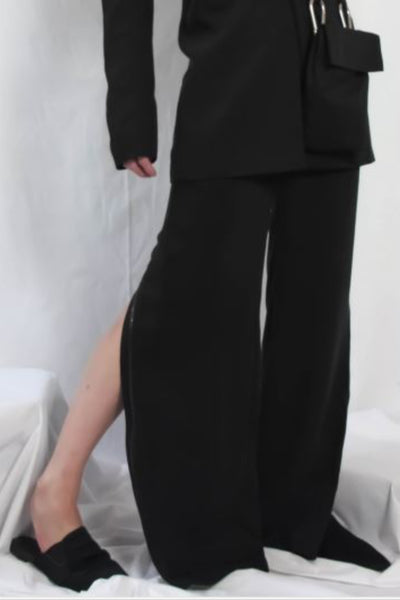 Shop Emerging Contemporary Urban Conscious Womenswear Brand Too Damn Expensive Black Wide Leg Trousers at Erebus
