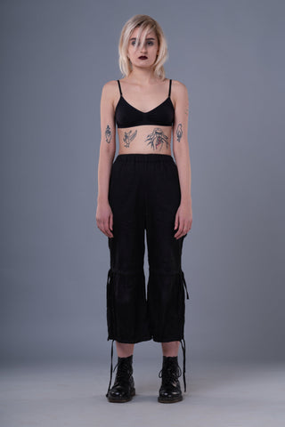 Shop Emerging Dark Conceptual Brand Anagenesis Braille Black Cropped Stand Trousers at Erebus